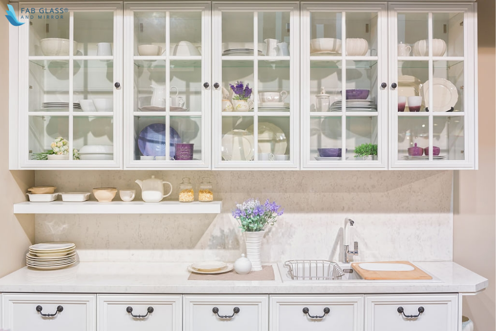 Styling Glass Front Kitchen Cabinets with Small Bowls, Large Bowls and Pitchers